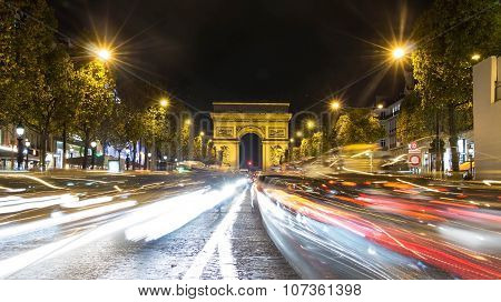 The High Traffic On Avenue Champs-elysees At Night, Paris, France.