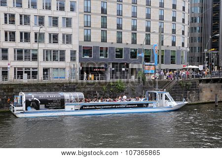 Berlin, Germany - July 25, 2015: Exterior View Of Buildings And A Boat Shipping At The River Spree I