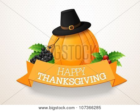 Happy Thanksgiving Day celebration with pumpkin, pilgrim hat, grapes, mistletoe and ribbon.