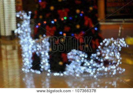 Backgrounds with deer and sledge of stars lights