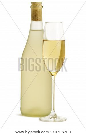 glass of champagne in front of standing prosecco bottle