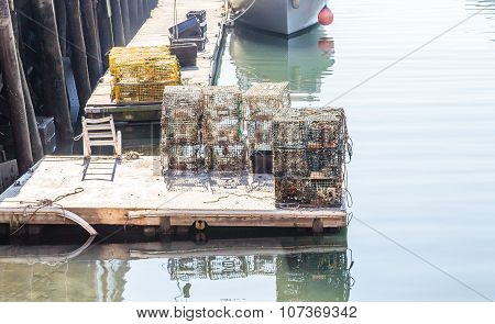 Lobster Traps On Dock In Harbor