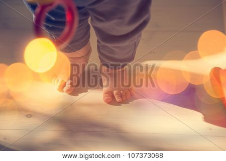 Small Baby Feet on Wooden Floor