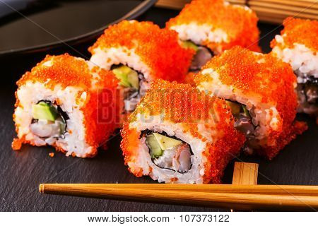 Sushi Roll With Crab, Avocado, Cucumber And Tobiko.