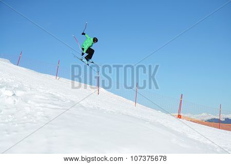 Val Di Fiemme, Italy - 13 December 2008. Ski Jumper In A Jump Over The Slope