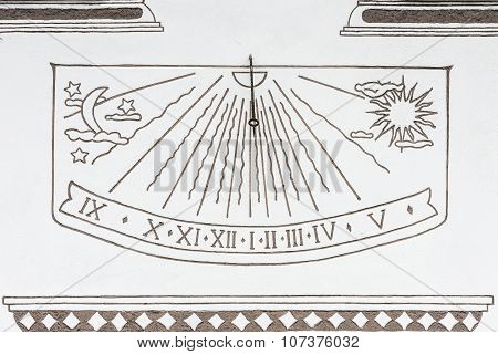 Ancient Solar Clock On The Wall Of A Rural House In Canazei, Italy