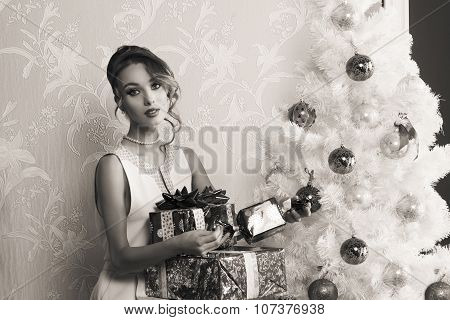 Fashion Girl With Christmas Presents In Bw