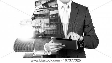 An Abstract Transparent Businessman Is Looking Something In The Tablet. Moscow City Business Centre