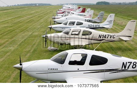 Prague, CZECH REPUBLIC - 22 May 2010: Cirrus aircraft series in the meadow in the background Airbus