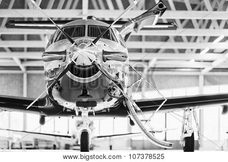 Single Turboprop Aircraft Pilatus Pc-12 In Hangar.