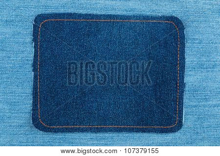 Frame made of denim with yellow stitching is on a light jeans