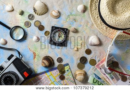 Travel accessories over world map