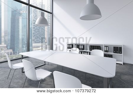 A Conference Room In A Modern Panoramic Office In Singapore. White Table, White Chairs, Two White Ce