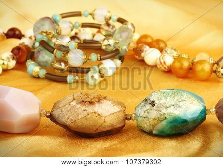 Jewelry Gem Stones On Golden Background