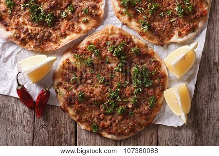 Asian Pizza Lahmacun Closeup On A Wooden Table. Horizontal Top View