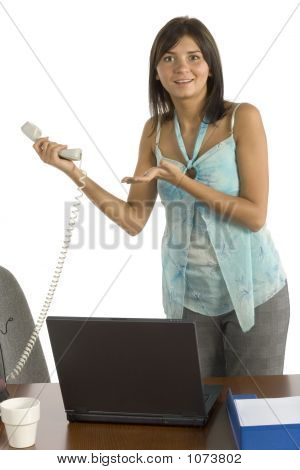 Female Office Worker On The Phone