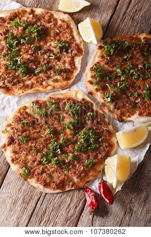 Turkish Food: Lahmacun Closeup On A Table. Vertical