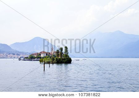 Panoramic view of Island of San Giulio on a romantic Italian lake Orta in the foothills of the Alps