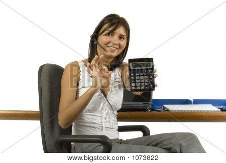 Businesswoman Displays Calculator'S Screen