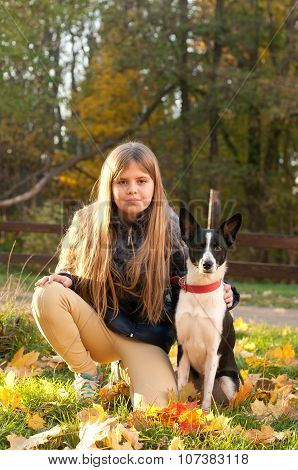 Girl with dog outdoor in autumn