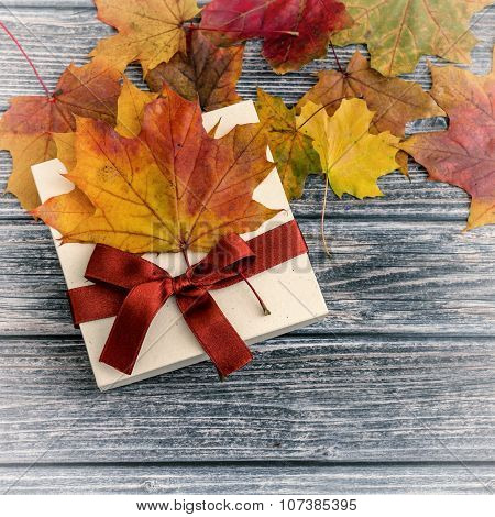 Holiday Present With Ribbon Over Wooden Background