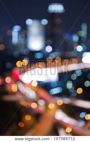 Night blurred bokeh light of city road interchange
