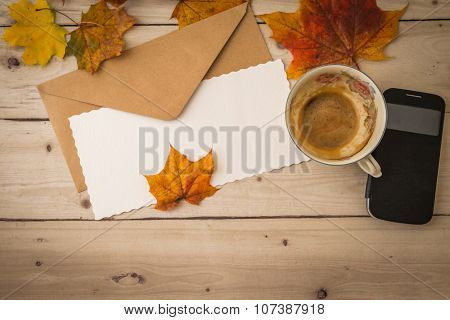 Letter With Coffee Cup And Smartphone On Wooden Background