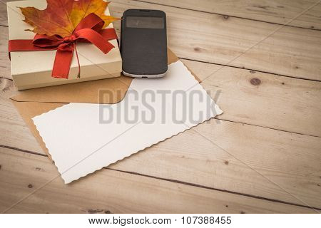 Letter With Smartphone And Cute Little Present