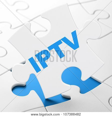 Web development concept: IPTV on puzzle background