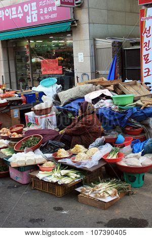 Jinju, South Korea. Trader onions.