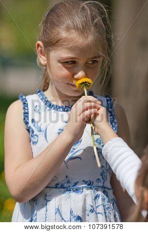 Teenager Girl Sniffing Flower