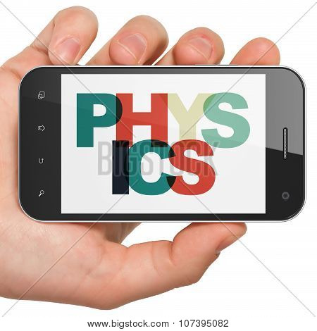 Studying concept: Hand Holding Smartphone with Physics on  display