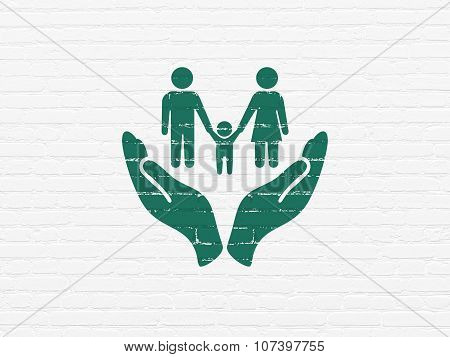 Insurance concept: Family And Palm on wall background