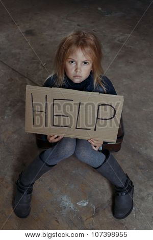 Little girl begging for help