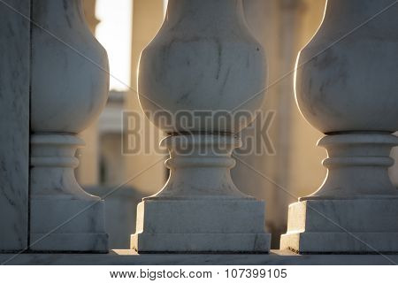 ARLINGTON, VA - SEPT 11, 2015: Close up view of the marble banisters within the Memorial Amphitheater in Arlington National Cemetery, back lit by afternoon sunshine.