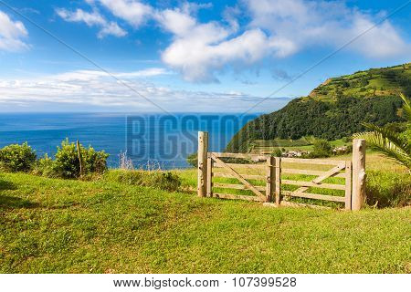 Fields And Fence Over Atlantic Ocean In Sao Miguel, Azores Islands
