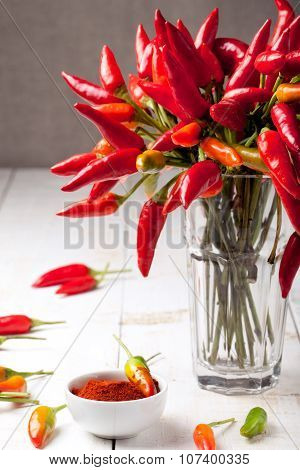 Chili peppers on a white wooden background