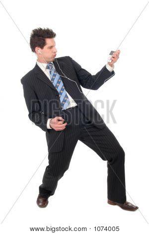 Young Businessman Enjoying Music