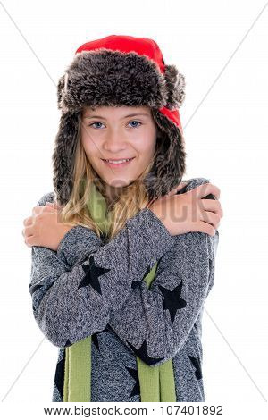 Portrait Of A Nice Blond Girl With Fur Cap And Scarf