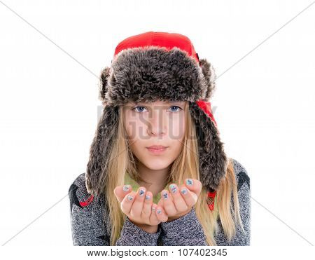 Blond Girl With Fur Cap And Scarf Blowing In To The Camera