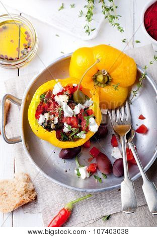 Baked stuffed bell peppers filled with cheese, capers and anchovies