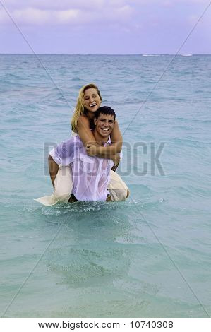 newly wed couple in the ocean