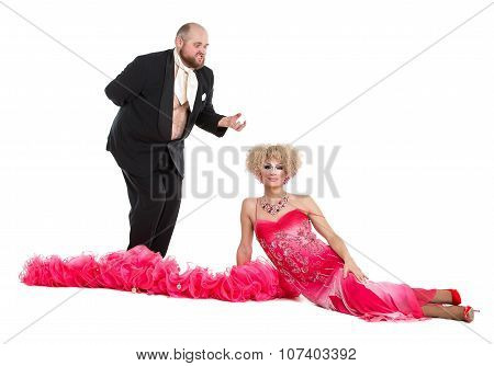 Eccentric Fat Man In A Tuxedo And Beautiful Lady In An Evening Dress Lying On Floor