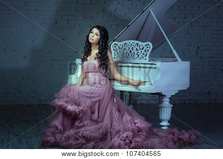 In A Dark Room Girl Sitting At The Piano.