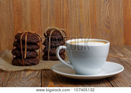 Cup Of Coffee And Two Stack Of Cookies
