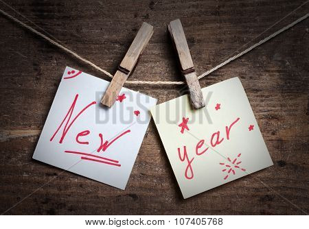 New Year card on wooden background