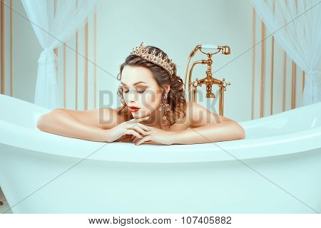 Beautiful Naked Young Woman Sitting In Expensive Jewelry Bath.
