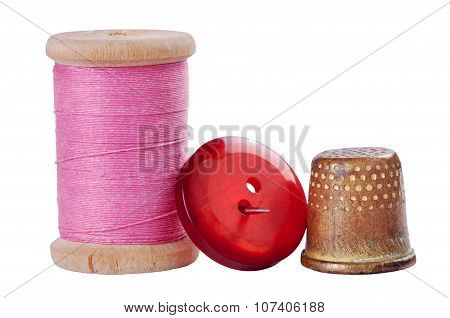 Old Thimble, Button And Needle With Pink Thread