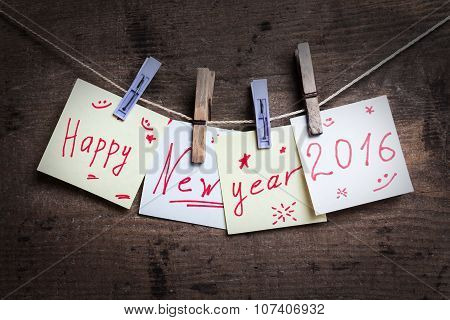 Happy New Year card on wooden background