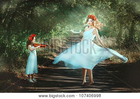 Girl Playing And Woman Dancing.